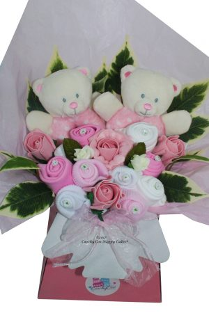 Twin baby girl lothes bouquet close up